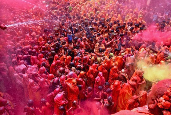 Men and Women Participate in Huranga Celebrations at The Dauji Temple